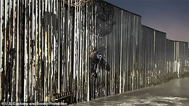 US border agents rescue a Mexican migrant, 25, after he was found hanging from wall in California