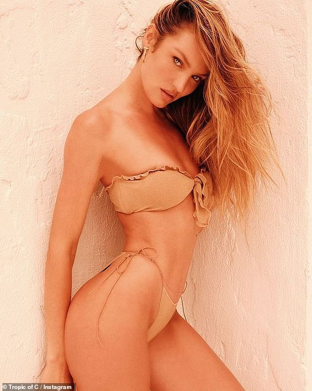 Victoria's Secret model Candice Swanepoel poses in a nude bikini