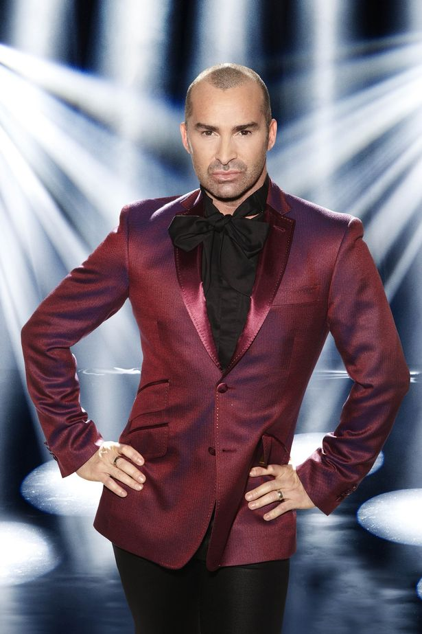 Louie Spence poses as a judge for Dancing On Ice
