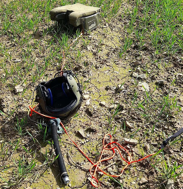 A helmet was found nearby, after the pilots were taken to hospital for treatment
