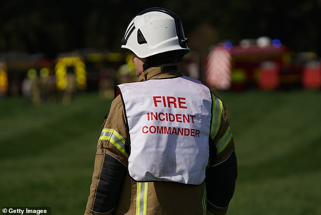 An incident commander with the Cornwall fire department at the scene of the crash