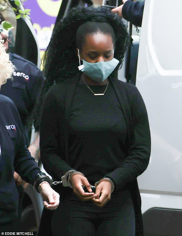 Kudi is seen in handcuffs outside Lewes Crown Court, where she was remanded in custody after pleading guilty to manslaughter