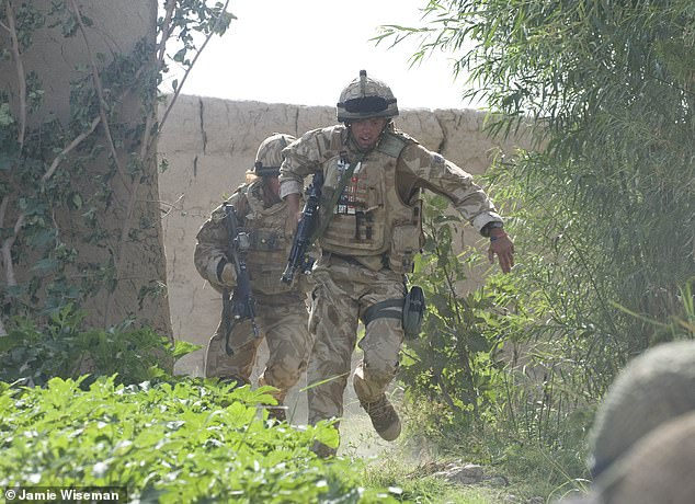 Engineers run from an explosion as they blast their way through compounds in the Green Zone