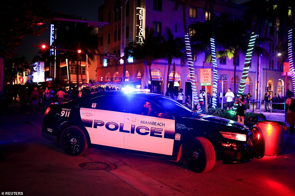 Miami Beach police officers enforce an 8pm curfew imposed by local authorities on spring break festivities, amid the coronavirus disease (COVID-19) pandemic