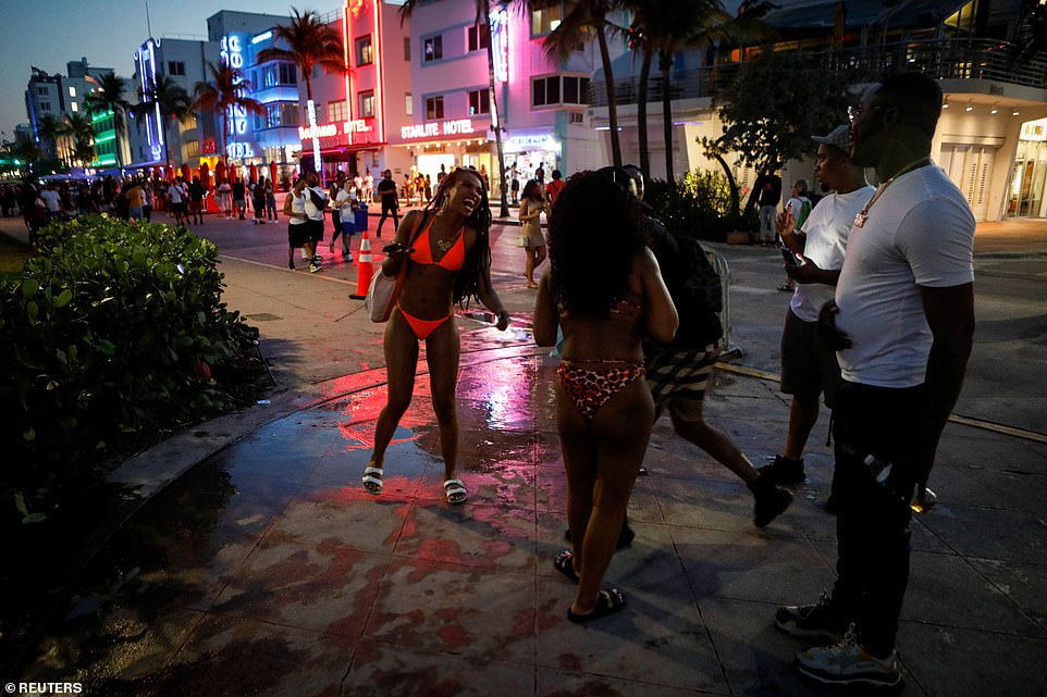 People take to the streets of Miami Beach despite the curfew enforced by local authorities