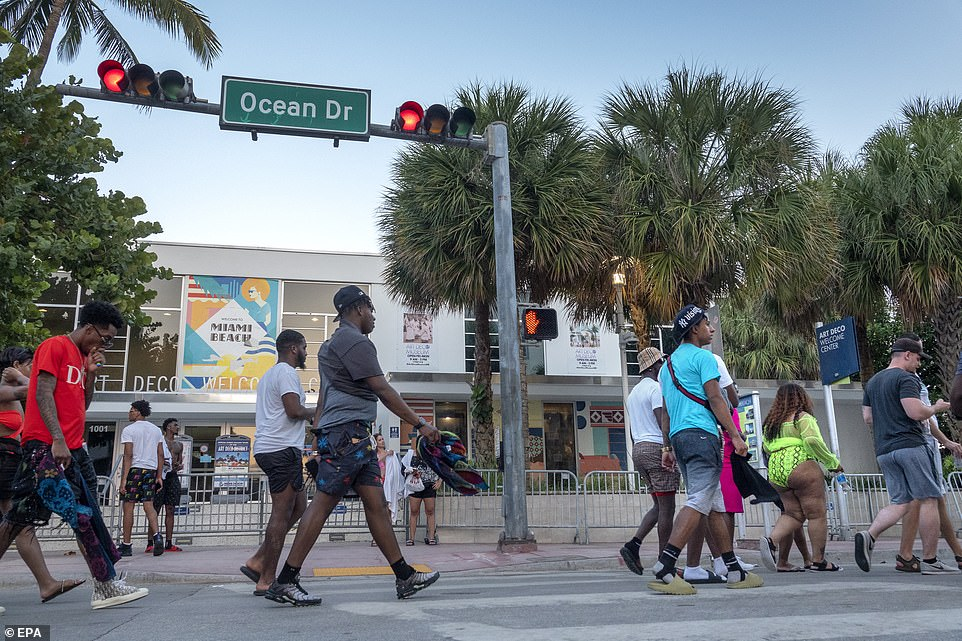 More partygoers convene on the streets of Miami Beach on March 25. The party took place on a walkway near the beach