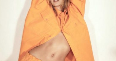 Hailey Bieber poses sensually in orange Balenciaga sweatsuit for Vogue Brasil
