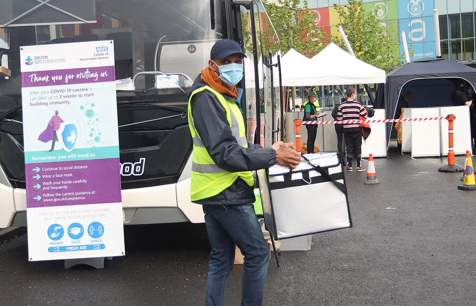 More medical supplies are brought to the scene as Britons of all ages were today invited to 'visit the vaccine bus'
