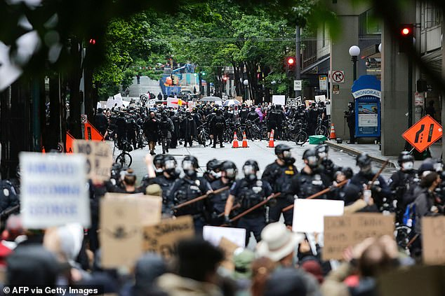 This was a protest on May 30, 2020 in Seattle, where police in full riot gear waited blocked the street from demonstrators
