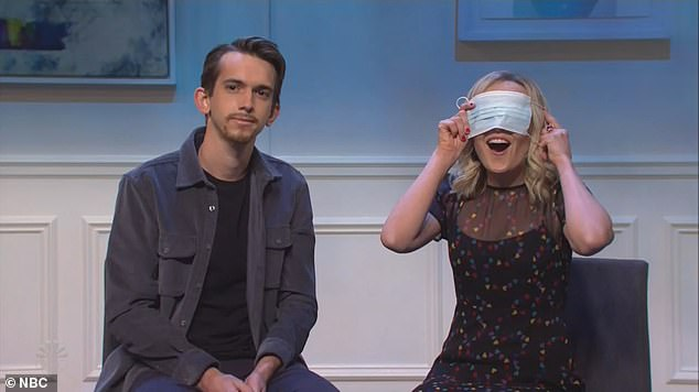 'Two young folks who started dating during the pandemic' were portrayed by Andrew Dismukes and Chloe Fineman. Fineman placed her mask over her head after taking a dislike to Dismukes goatee