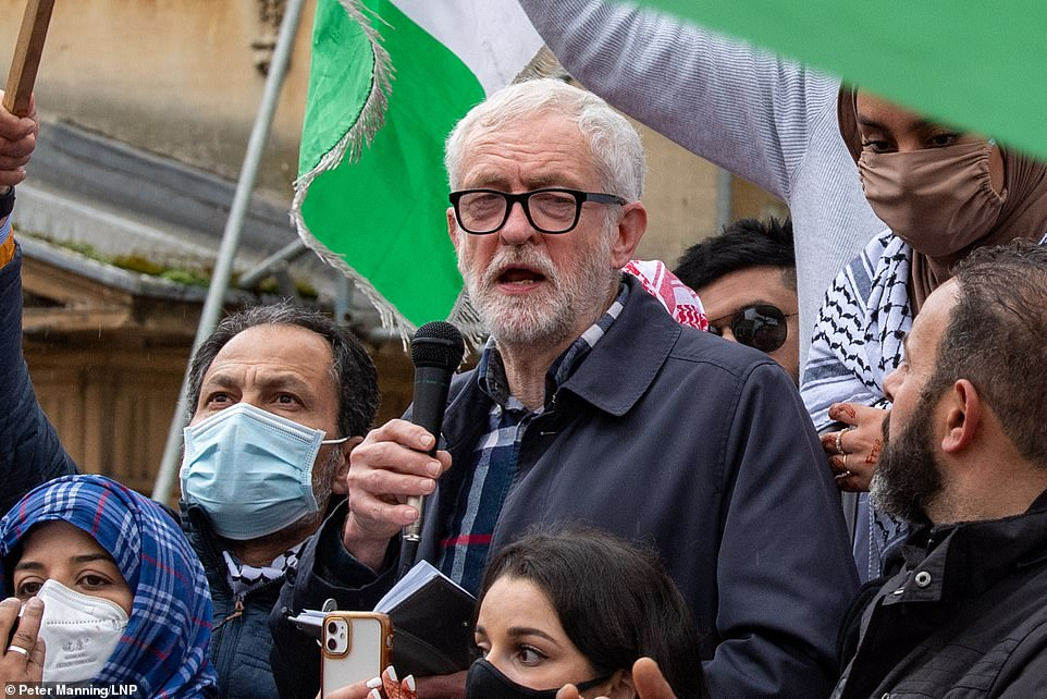 While 'appalling' incidents of antisemitism have been reported, many peaceful pro-Palestinian protests have taken place across Britain - amid rising tensions in Israel. Pictured:Former Labour Party leader Jeremy Corbyn addresses the crowd in Bonn Square at the 'Speak up for Palestine' demonstration held in Oxford