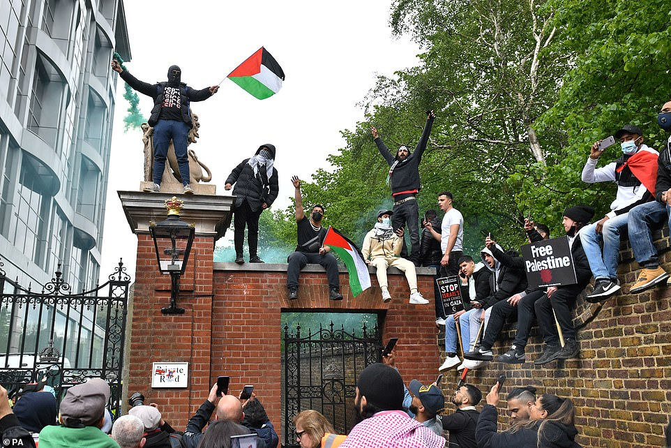 At Kensington Palace demonstrators scaled a wall as they held placards that read 'Free Palestine'