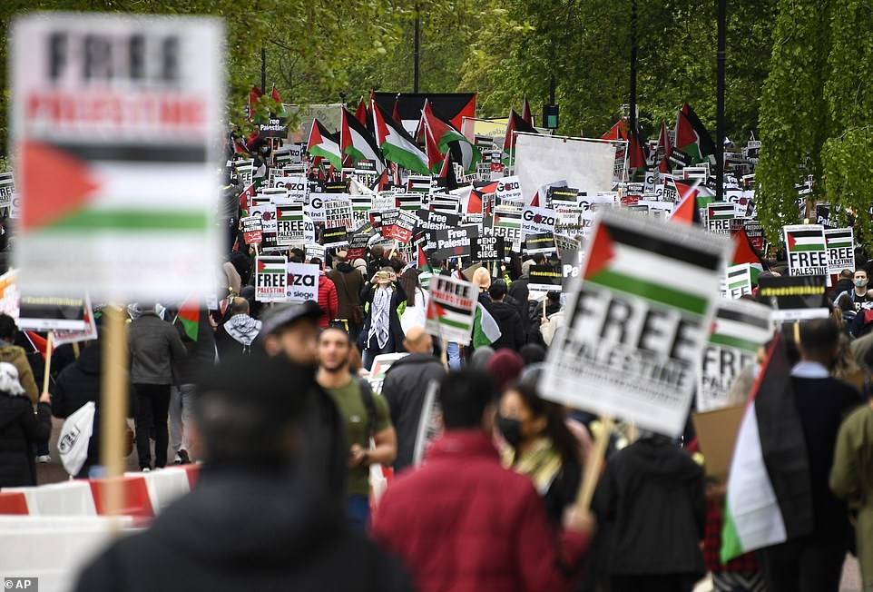 Demonstrators waved placards as they marched towards Kensington on Saturday afternoon