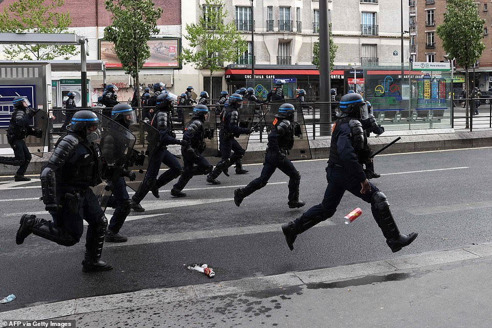 PARIS:French riot police run towards a pro-Palestinian rally called against Israel's bombardment of the Palestinian Gaza Strip, in Paris on May 15, 2021