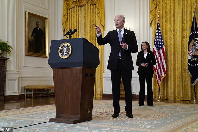 Biden takes questions after delivering remarks on his administration's COVID-19 response, while Harris looks on