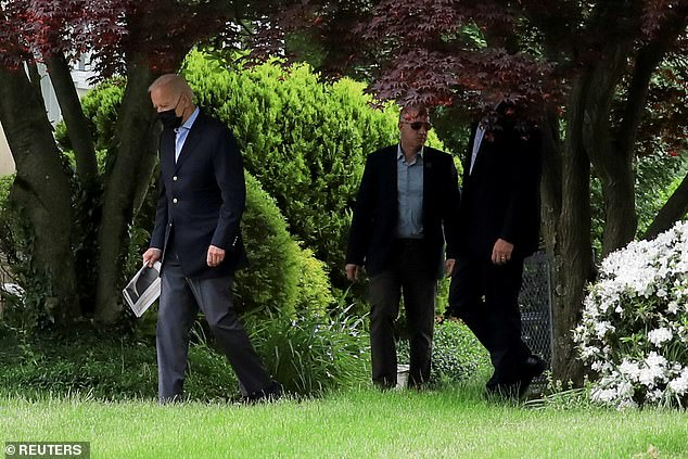 President Biden wore a dark mask outdoors on Sunday as he made his way to and from church, despite new guidance that it was unnecessary for fully vaccinated people