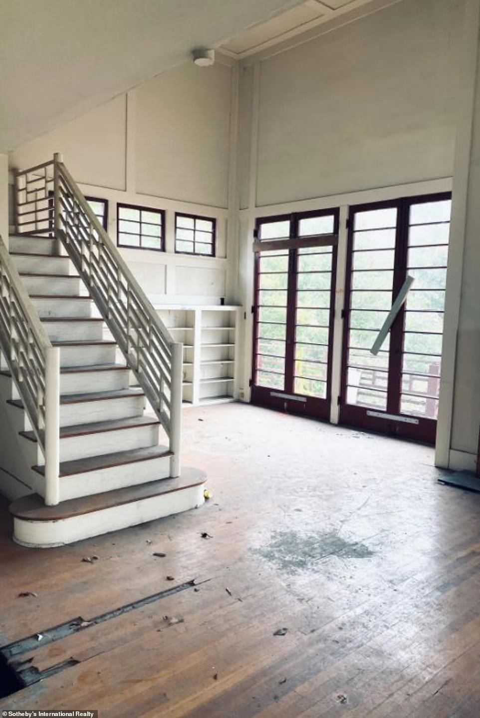 The 2,500-square-foot home was built in 1921 andfeatures a dramatic two story living room and open staircase