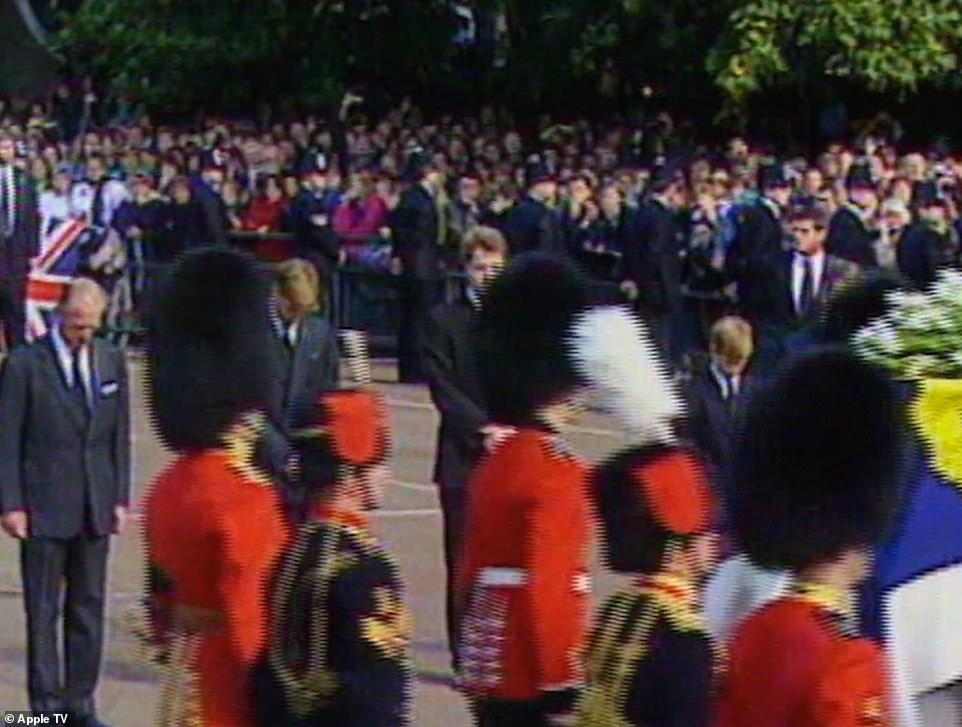 Footage shown in the clip shows William (second left) and Harry (right) as they grieved for their mother Diana