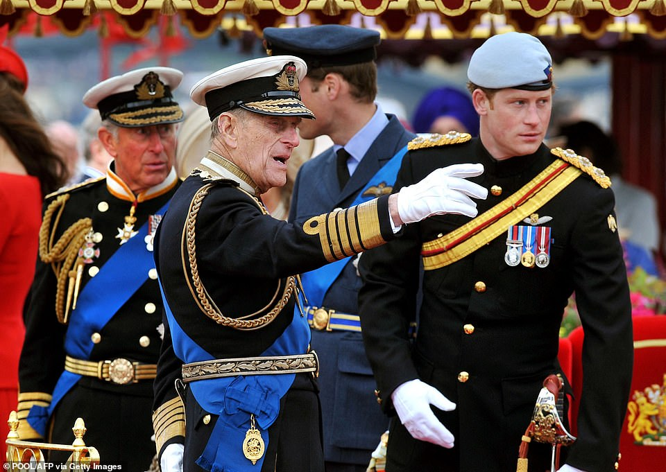 Prince Charles, Prince Philip and Prince Harry appear during the Thames Diamond Jubilee Pageant in London on June 3, 2012