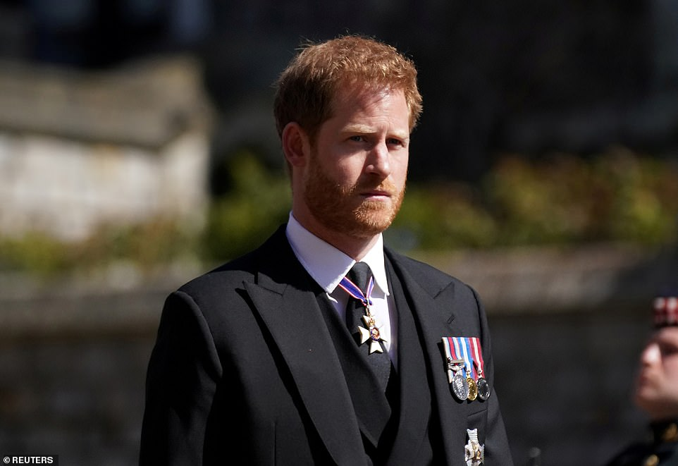 Prince Harry walks in the procession at Windsor Castle during the funeral of his grandfather Prince Philip on April 17