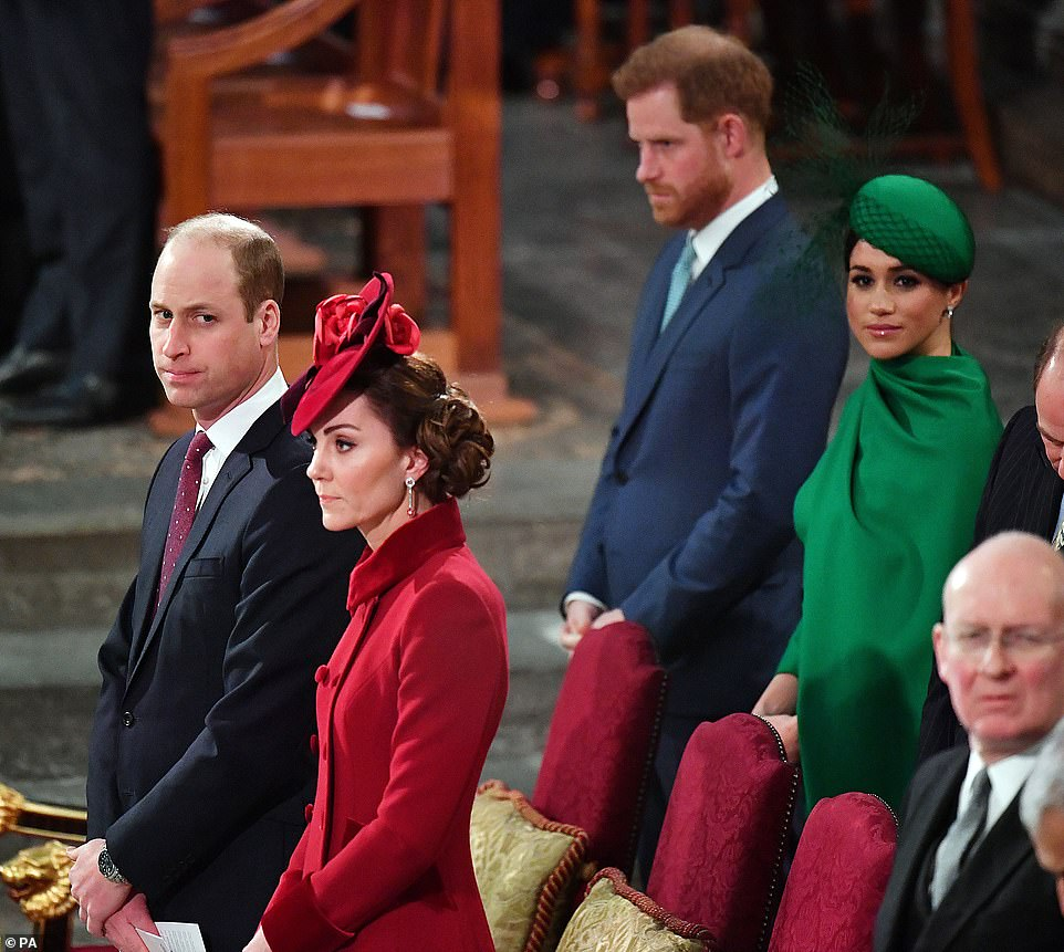 The Duke and Duchess of Sussex stand behind the Duke and Duchess of Cambridge at the Commonwealth Service at Westminster Abbey on March 9 last year, in what was Harry's last official royal engagement with Meghan in London