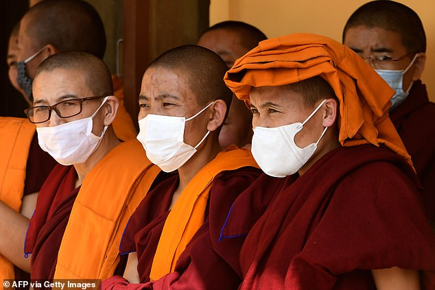 Pictured:Exiled Tibetan Buddhist nuns take part in a prayer procession at Choeling Monastery in Kathmandu on March 10, 2020 [file photo].Vikki Hui Xin Han, who was training to be a nun says she only ever met Ogyen Trinley Dorje four times, but is claiming spousalsupport