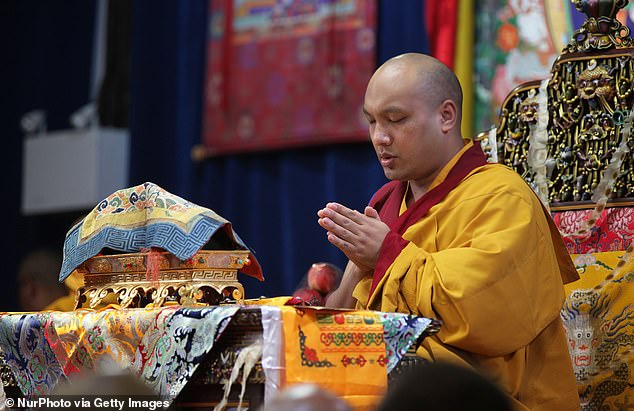 Han, who was training to be a Buddhist nun, claims that she got pregnant by Dorje at a New York monastery in 2017. But after that, she says their relationship 'evolved into a loving and affectionate relationship,' which saw the pair exchange text massages, through which Dorje (pictured praying in 2017) sent her more than $700,000