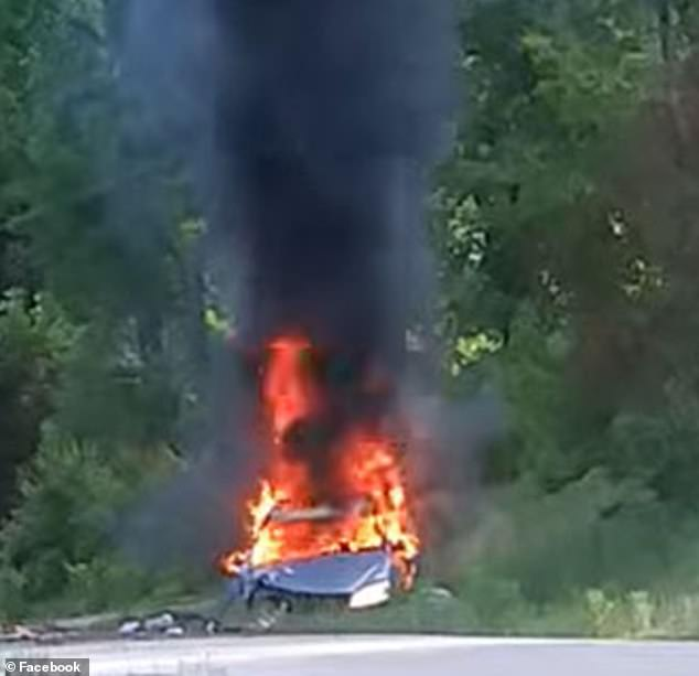 A gas-hoarding South Carolina woman has suffered burns to her body after her car crashed and burst into flames while she was fleeing from police. Her burning vehicle is pictured