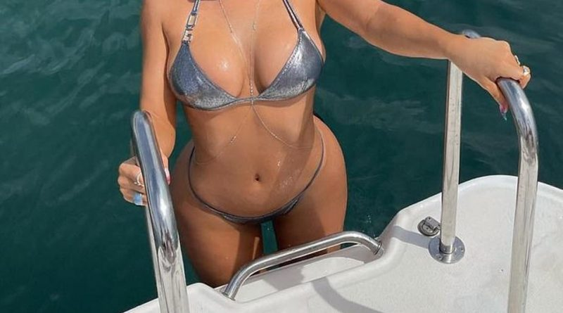 Kylie Jenner looks spectacular in a silver bikini after 'filing trademark for brand name Kylie Swim'